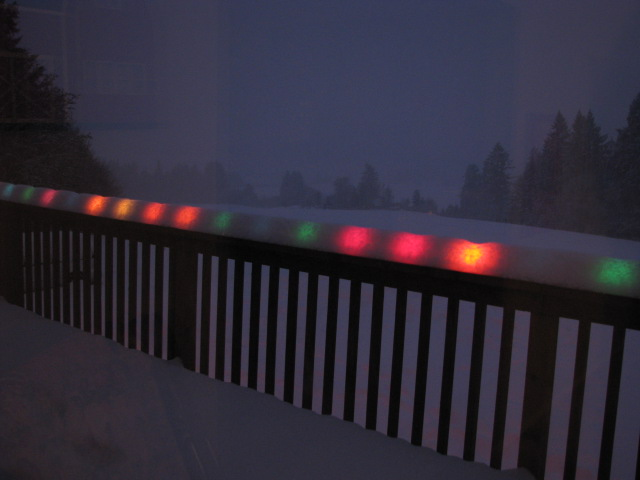 snow-over-christmas-lights